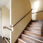 Fire rated steel stairs clad in timber, finished in smoked oak stain with timber flooring to match.