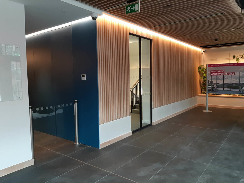 Wall panelling and lift area